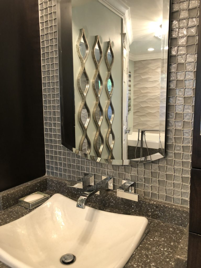 Bathroom Sink, Mirror and Faucet.